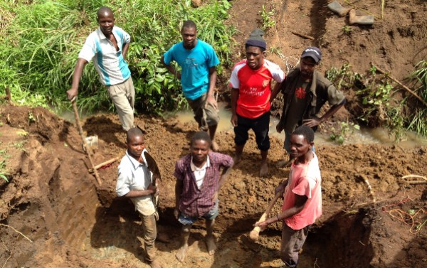 Excavation for the bridge foundations start with help from Elijah and 2 of our gardeners